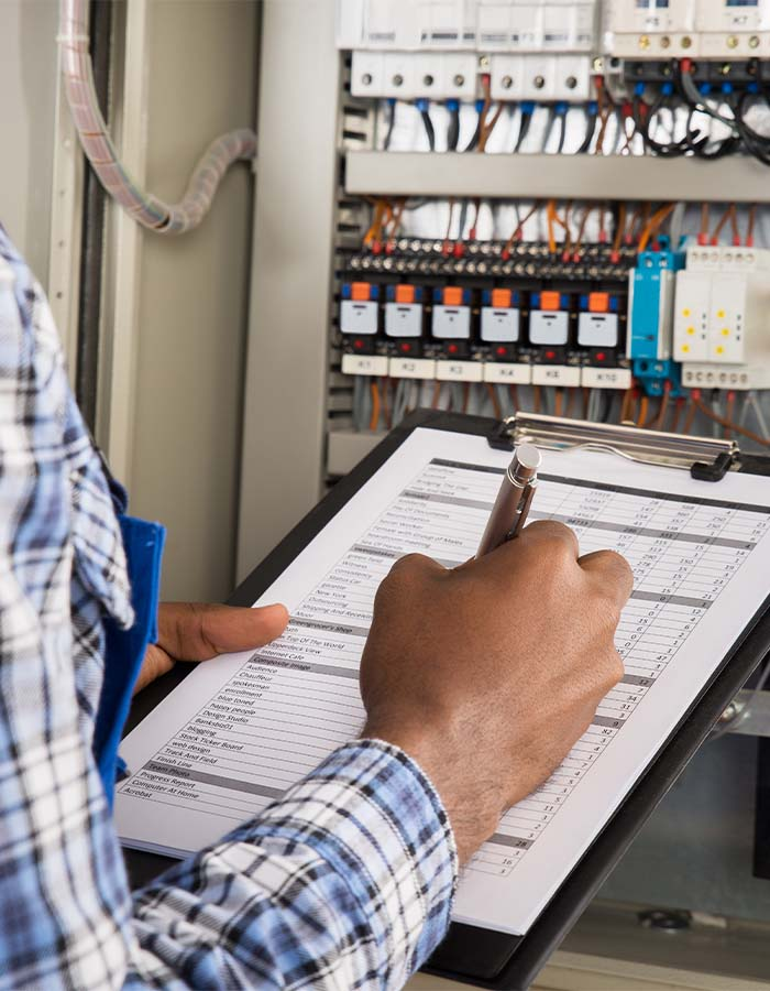 an electrician with a checklist; electric services